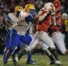 Crete Monee's Jonathan Schultz pressures Ottawa quarterback William Hoffman 