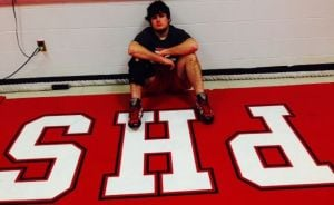 Portage wrestler Williams not letting knee injury keep him off the mat