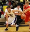 Merrillville's Jake Rapopovich, left, tries to control the ball while Andrean's Matt Ruberry defends