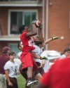 T.F. South's Efie Ovie makes a leaping catch Saturday at Richards' 7 on 7 tournament.