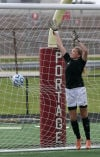 Valparaiso scores a goal against Chesterton goalie Anne Marie Radzik during Saturday's Class 2A Portage Sectional title match.
