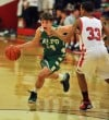 Valparaiso's Brody Wilson drives past Portage's Jordan Simpson 
