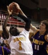 Gavit's Randy Ferguson blocks a layup by Lew Wallace's Richard Walsh during Friday's semifinals of the Class 3A Hammond Sectional.
