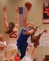 Lake Central's Rachel Bell shoots between Crown Point's Katie Pawlowski and Sydney Taylor