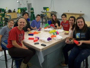 Eighth-graders craft wooden cars for needy children