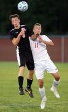 LaPorte's Jake Tobar, left, and Crown Point's Goran Trimoski go up for a header