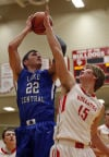 Lake Central's Cory Dickelman shoots over Crown Point's Sasha Stefanovic on Friday night.