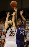 Merrillville's Jaz Tailey shoots from the perimeter against Warsaw on Saturday night.