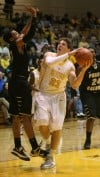 Purdue Calumet's Warren Gordon tries to block a shot by Valparaiso University's Matt Kenney