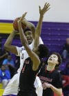 T.F. North's Jaylon Kyles shoots against Eisenhower's Kejuan McIntosh in North's 79-78 win.