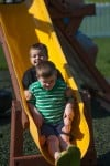 Connor brothers Brayden and Logan play on their slide
