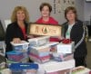 Curves members fill shoe boxes with donations