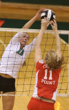 Valparaiso's Rachel Bontrager, left, and Crown Point's Peyton Yelich battle at the net