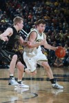Michigan's Zack Novak is guarded by Purdue's Robbie Hummel.