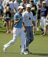 Rory McIlroy, of Northern Ireland, walks with Jeff Knox, right, down the eighth fairway during the third round of the Masters on Saturday.