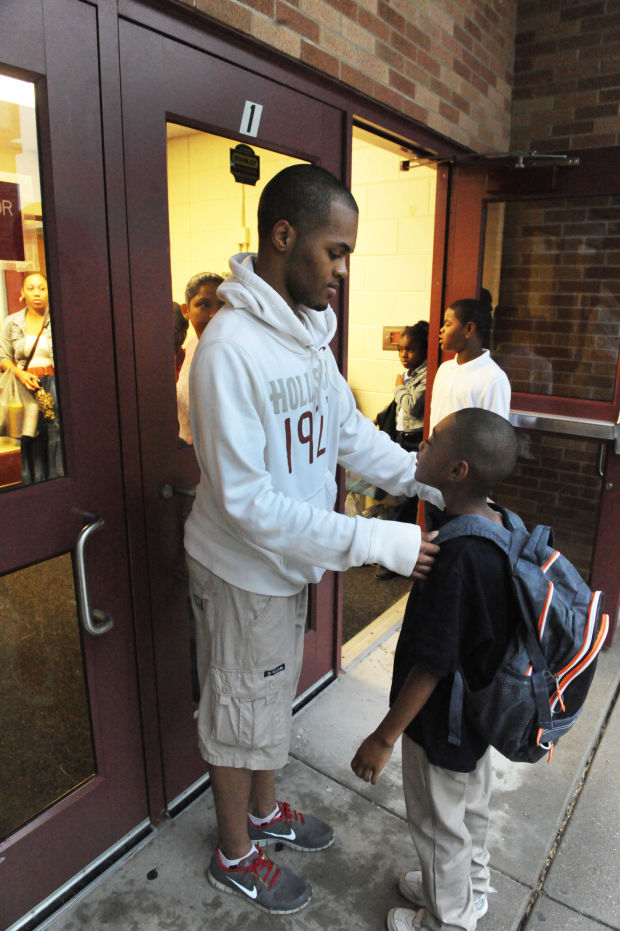 Men take children to school for Million Father March