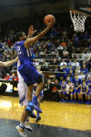 Lake Central's Joe Bannister drives for a layup against Homestead during Saturday's Class 4A Lafayette Jeff Semistate.