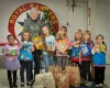 Lansing Girl Scouts collect food for needy