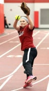 Portage High School's Kaitlin Doud winds up while pitching during practice.