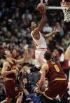 James leads Cavaliers past Bulls in OT