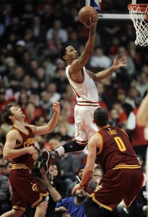 James leads Cavaliers past Bulls in OT