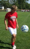 Drake Bowers, Munster, dribbles soccer ball