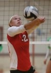 Munster's Morgan Switalla sets during the Mustangs' match with Valparaiso on Thursday night.