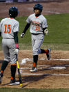 Morgan Park's Christian Lipscomb scores against West Side in the first inning during Wednesday's McDonald's RailCats High School Challenge at U.S. Steel Yard.