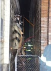 Fire displaces at least 10, damages 2 buildings in E.C.