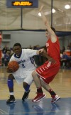 Lake Central's Tye Wilburn tries to get past Munster's Drew Hackett