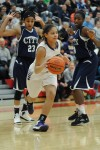 Merrillville junior guard Myranda Harris steals a pass intended for Michigan City sophomore guard Michal Miller on Saturday night.