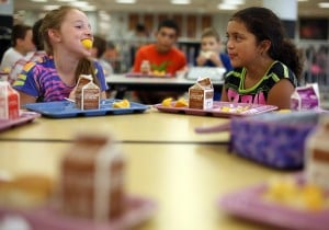 Local schools vow to continue in government lunch program