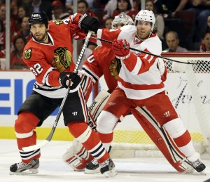 Hawks' Oduya, Kruger clip Wings in 3rd