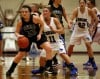 Lowell's Kalyne Godbolt, left, drives past Lake Central's Tara Zlotkowski