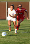 Merrillville's Erika McClinton, left, and Kankakee Valley's Kara Gouwens chase the ball at Thursday's Class 2A Crown Point Sectional.