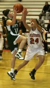 Whiting's Jen Hennessey shoots over the defense