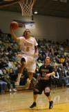 Valparaiso University's Jordan Coleman shoots over Purdue Calumet's Drew Ridlen