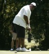 Stacey King putts