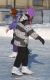 Sisters Olivia and Alexandra Duensing try out their Christmas skates at the Crown Point Sportsplex