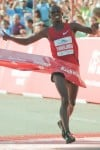 Runner Sammy Wanjiru crosses the finish line taking first in the Chicago Marathon