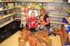 Children buy groceries for St. Clare Health Clinic food pantry
