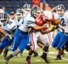Portage's Avery Sanders gets the ball knocked lose by Lake Central's Nick Lucas