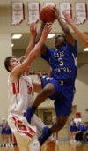Lake Central's Robert Ryan drives through three Crown Point defenders on his way to the basket Friday.