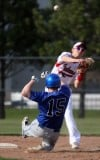 Lake Central's Chuck Alexa tries to break up a double play by Portage's Patrick Derr on Friday.