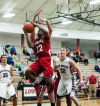 Portage's Shamari Lewis draws a foul on Lowell's Eric Zukauskas