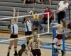 Lake Central junior Alyssa Stepney blocks a hit attempt from Chesterton's Aubrey Nagdeman on Thursday night.