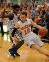 LaPorte's Blake Arnett drives past Michigan City's Jaronde Boyd on Saturday.