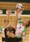 LaPorte's Clair Marshall tries to block a spike attempt by Valparaiso's Madison Olson.