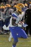 Crete Monee's LaQuon Treadwell runs for a first-half touchdown