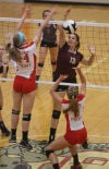 Chesterton's Brittany Milzarek spikes over Crown Point's Jessica Yukich and Alyssa Kvarta